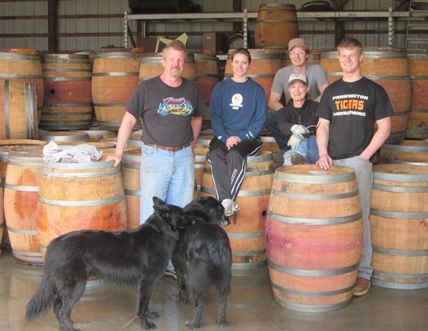 Our family in Minneapolis, MN surrounded by our premium wine barrels