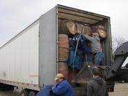 A ful load of wine barrels, rain barrels, and planters